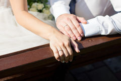 Wedding ring on couples hand Stock Photo