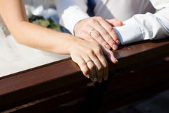 Wedding ring on couples hand Stock Images