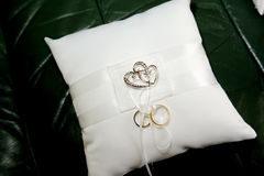 Wedding ring cushion. Weding ring cushion with two rings and love hearts Stock Image