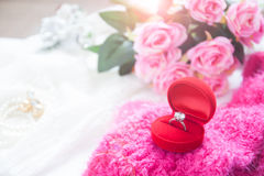 Wedding ring, Diamond ring in red box with pink roses Royalty Free Stock Images
