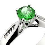 Wedding ring with diamond on white background. Sign of love. Eme. Wedding ring with diamond on white background.  Emerald Stock Images
