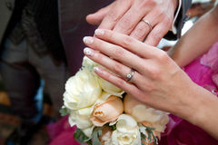 Wedding ring. The eternal oath of ring, against the background of the bridal bouquet you two friends show off in front of the scene Royalty Free Stock Photo