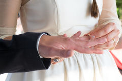 Wedding ring exchange by the bride Royalty Free Stock Images