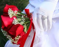 Wedding ring and flowers. This image can symbolize love and commitment through the ritual of marriage Royalty Free Stock Images