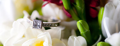 Wedding Ring in Flowers Stock Image