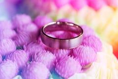 Wedding ring on flowers Stock Photo