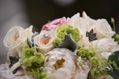 Wedding ring in flowers stock photography