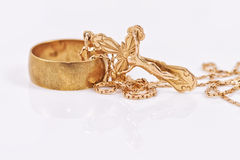 Wedding ring and gold Orthodox cross Royalty Free Stock Image
