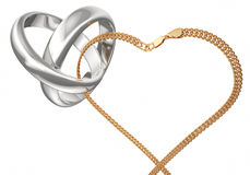 Wedding ring. Gold rings and chain on a white background. Rings connected gold chain. Heart of the chain Royalty Free Stock Photography