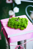 Wedding ring. And green plant decorations on cute pink table Royalty Free Stock Photos