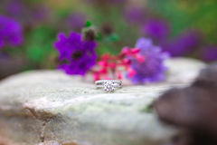 Wedding ring on grey rock Royalty Free Stock Photo