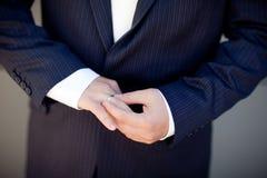 Wedding ring of the groom Stock Photo