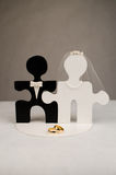 Wedding ring and grooms hands with puzzle. Engaged in hand-shaped puzzle and wedding band. Cake topper Stock Photos