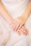 Wedding Ring on Hand With Gown royalty free stock images