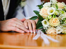 Wedding Ring and hands. Bride & Groom, Hand married, wedding flowers Royalty Free Stock Image