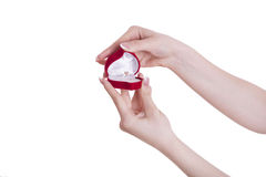 Wedding ring. Hands holding an engagement ring in an open box. Photo on a white background stock photos