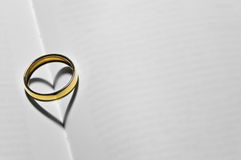 Wedding ring with heart Stock Photography