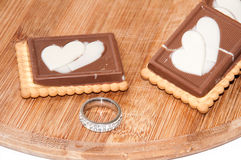 Wedding ring and heart in chocolate biscuits Stock Photo
