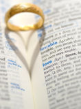 Wedding ring and heart shadow. On love word Stock Photo