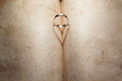 Wedding Ring and heart shaped shadow Stock Photography