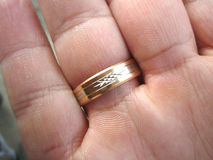 Wedding ring on his finger Royalty Free Stock Image