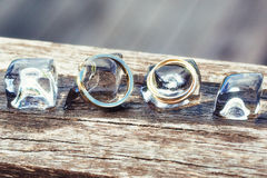Wedding ring with ice cubes Royalty Free Stock Images