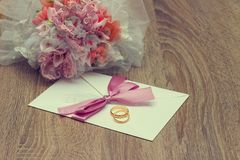 Wedding Ring And Invitation. Wedding Invitation with wedding rings and bouquet Stock Photography
