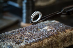 A wedding ring just after goldsmith work. Royalty Free Stock Image