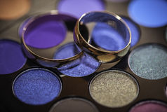 Wedding ring on the makeup kit for eyes Royalty Free Stock Photo