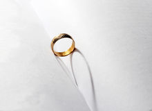 A wedding ring in the middle of the book Royalty Free Stock Photography