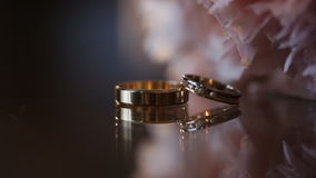 Wedding ring near a beautiful bouquet