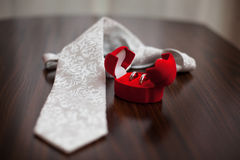 Wedding ring and necktie Stock Photos