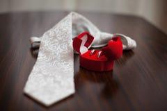 Wedding ring and necktie Stock Photos