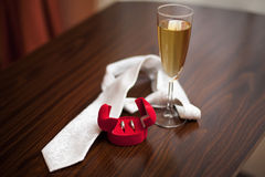 Wedding ring and necktie Royalty Free Stock Image