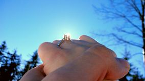 Wedding ring. Nice wedding ring. Sun rays comming through the diamond Royalty Free Stock Photography