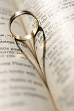 Wedding ring. On the pages of opened Bible Royalty Free Stock Photos