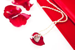 Wedding ring and pearl necklace with red box Royalty Free Stock Photos