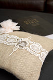 Wedding ring on pillow with bible Stock Images