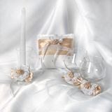 Wedding ring pillow. Wedding satin ring pillow, candle and glasses stock photo