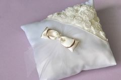 Wedding ring pillow. Wedding satin ring pillow with flower Royalty Free Stock Photography