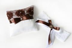 Wedding ring pillow. Wedding satin ring pillow and garter Royalty Free Stock Photography