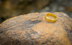 Wedding ring put on stone Stock Photos
