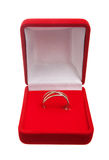 Wedding ring in red box. Isolated over white background stock photography