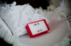Wedding ring. In red box on white pillow Royalty Free Stock Photos