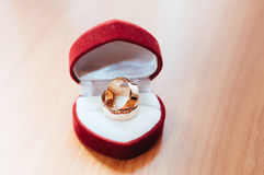 Wedding ring in red gift box heart shape on the Royalty Free Stock Photography