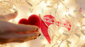 Wedding ring in red gift box on Valentines day. Wedding ring in red gift box in shape of heart and valentines on calendar page. Lights on the background stock footage