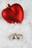 Wedding ring and red heart Stock Photography