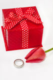 Wedding ring with red tulip and red gift box Royalty Free Stock Photo