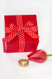 Wedding ring with red tulip and red gift box Stock Photo