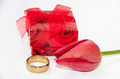 Wedding ring with red tulip and red gift box Royalty Free Stock Images